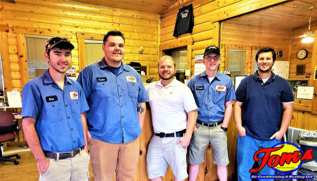 Team photo of Tom's Air Conditioning and Heating service technicians